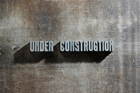 Image of a Under Construction sign with a metallic background texture Stock Photo - 12899849