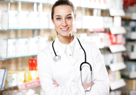 portrait of  smiling young woman pharmacist with stethoscope photo