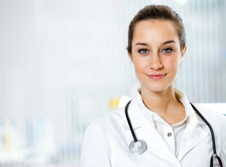 pharmacist: at pharmacy: portrait of  smiling young woman pharmacist with stethoscope