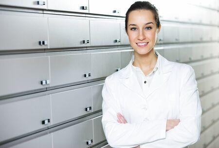 portrait of a female pharmacist at pharmacy photo