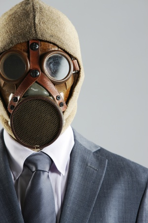 portrait of businessman in a gas mask photo