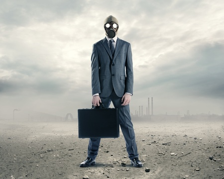 doomsday: doomsday: portrait of businessman in a gas mask  with suitcase