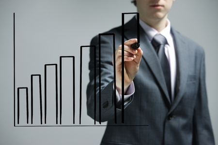 stock photography: Businessman drawing a uptrend chart on screen Stock Photo
