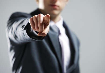 power point: businessman  hand pointing out at you Stock Photo