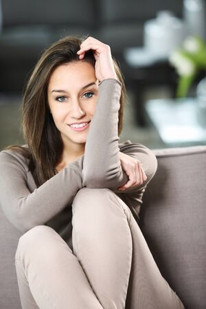 only one young woman: portrait of young attractive woman at home