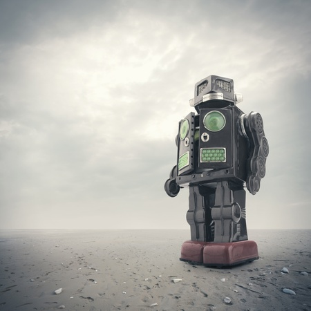 tin robot: a  retro tin robot toy on an apocalyptic background Stock Photo