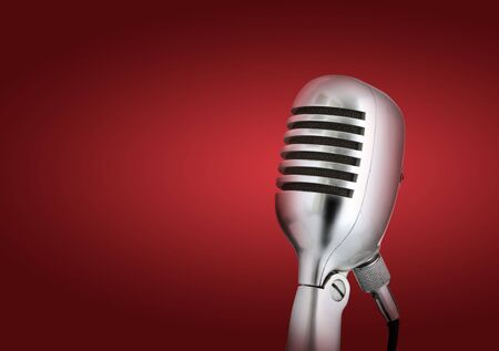adulation: Retro style microphone.Red background