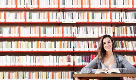 choose university: Portrait of a student  girl studying at library