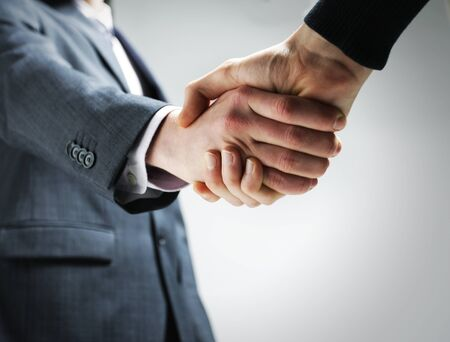 two hands: Two businessmen shaking hands. Stock Photo