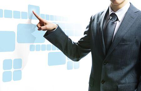 Businessman pressing virtual buttons photo