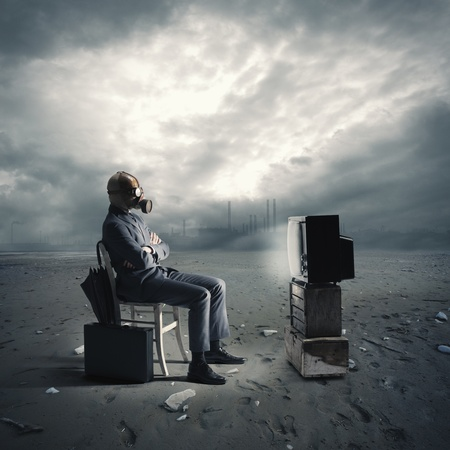 doomsday: businessman with gas mask watching TV