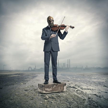 post apocalypse: businessman with gas mask, plays the violin