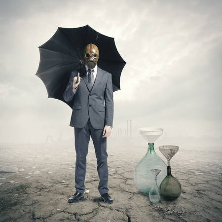 apocalypse: Global Warming:Businessman waiting for the rain Stock Photo