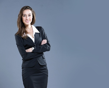 Attractive businesswoman with her arms crossed. Stock Photo - 13410424