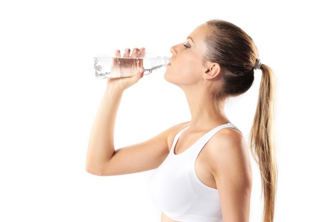 water bottles: young woman drinking water, on white background
