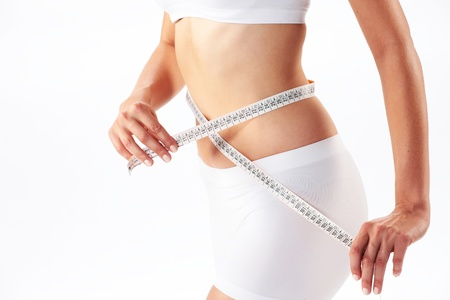 woman measuring her abdomen with a meter-stick Stock Photo - 13410463