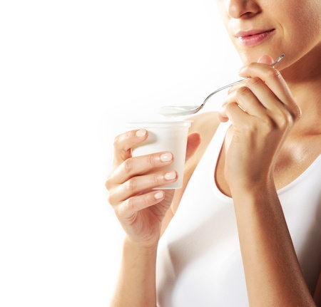 Young woman eating yogurt , close up photo