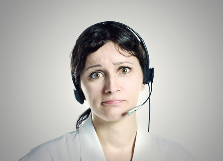 Cute girl with headset, work problems photo