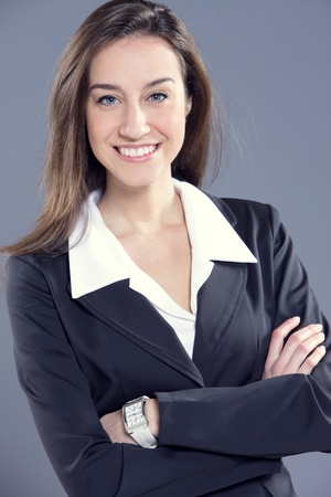 Attractive businesswoman with her arms crossed. photo
