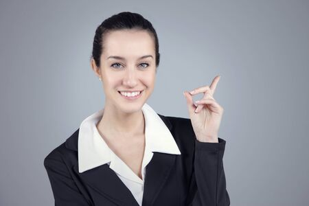 Young beautiful businesswoman pointing at copyspace Stock Photo - 13508642