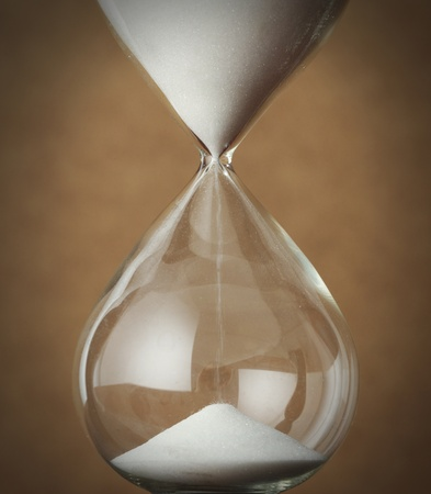 hourglass: time concept: vintage hourglass close up