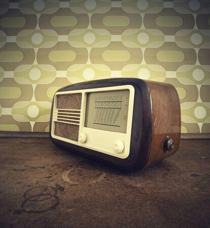 retro styled imagery: antique radio on vintage background