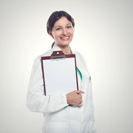 portrait of a smiling woman pharmacist photo