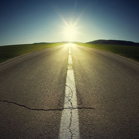 bright future: asphalt of country road in backlight