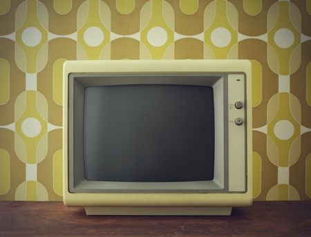 Old computerTV screen. on vintage background photo