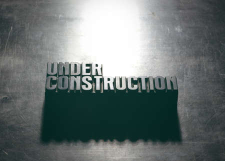 Under Construction sign with a metallic background texture photo