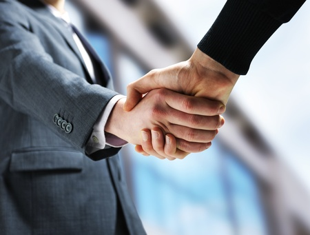 hands shaking: Two businessmen shaking hands. Stock Photo