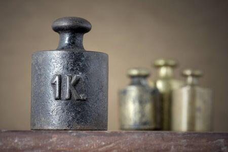 calibration: Vintage 1 kilogram calibration iron weight  Stock Photo