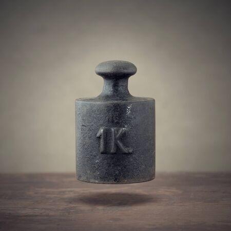 kilogram: Vintage 1 kilogram calibration iron weight  Stock Photo