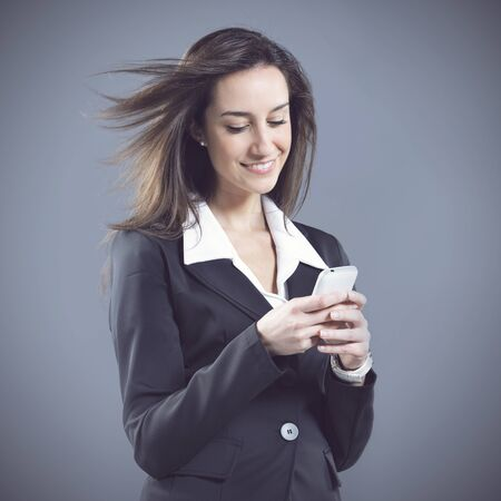 woman business,  text messaging on cell phone Stock Photo - 13827526