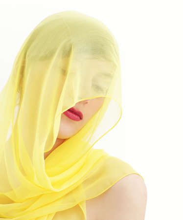 Young beautiful woman hidden by a veil  photo