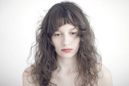 long depression: portrait photo of a sad and depressed young woman