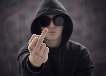 young guy showing the  middle finger Stock Photo - 13846379