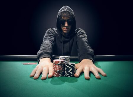 Professional poker player betting everything on one hand photo