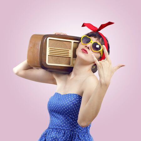Portrait of a Pin Up listening to the radio photo