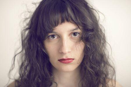 portrait photo of a sad  young woman photo