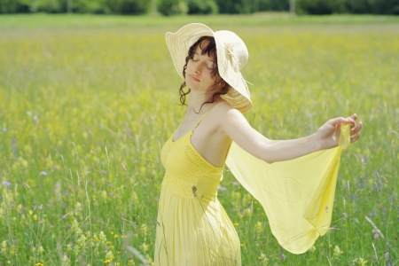 Young woman enjoying a summer day on the field Stock Photo - 14179728