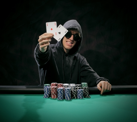 the winner of the tournament shows the winning cards photo