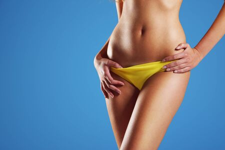 Sexy oman wearing string bikini, close-up of abdomen Stock Photo - 14179729