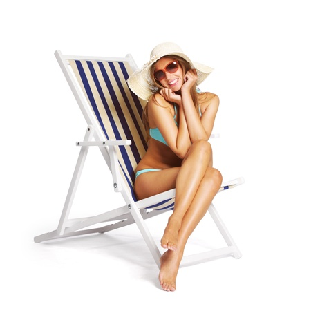 nude woman sitting: Beautiful young woman relaxing on beach chair, white background
