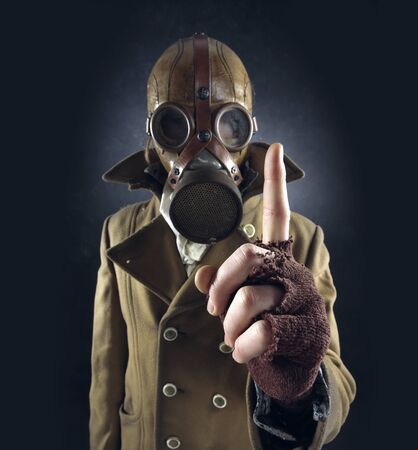 sullen: grunge portrait man in gas mask  Stock Photo