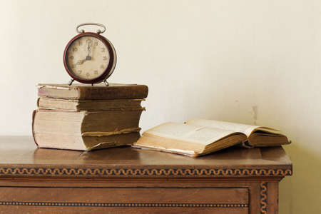 old alarm clock on old books, copy space photo
