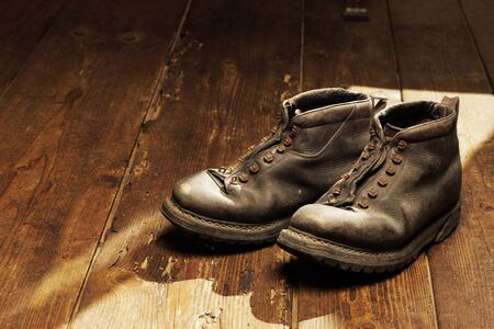 Old boots on the wooden floor, copy space photo