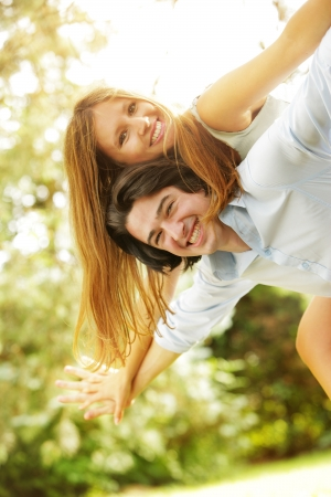 2 people: a young couple in love having fun in the park Stock Photo