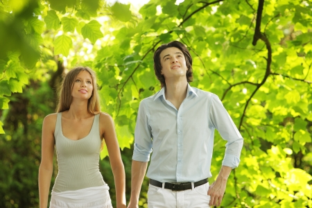 a young couple in love walking in the park Stock Photo - 14447434