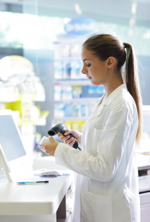 bar code: Portrait of a female pharmacist at pharmacy